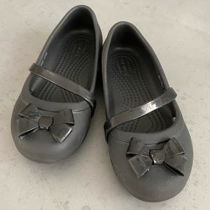 CROCS Shoes - Girls size 11, black Mary Jane Crocs with bow.